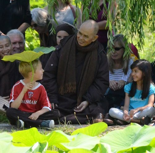 My son Raphael, with lotus flower leaf, with Thich Nhat Hanh in Plum Village, 2012