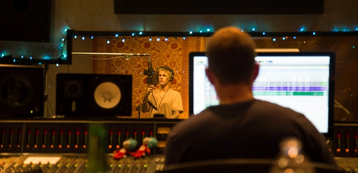 Josh Gudwin looks on as Justin Bieber sings a take at the Record Plant in LA. This picture was taken during the sessions for the Purpose album.